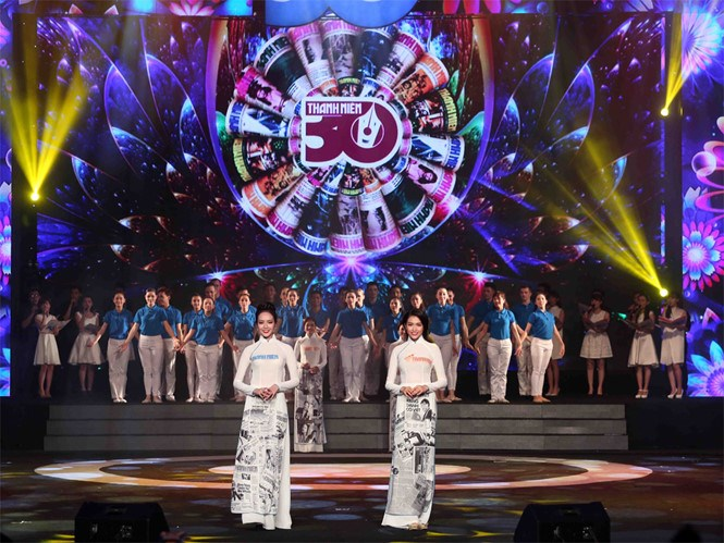 Models don ao dai with Thanh Nien-themed patterns at an event on January 3, 2016 to celebrate the newspaper's 30th birthday. Photo: Dao Ngoc Thach