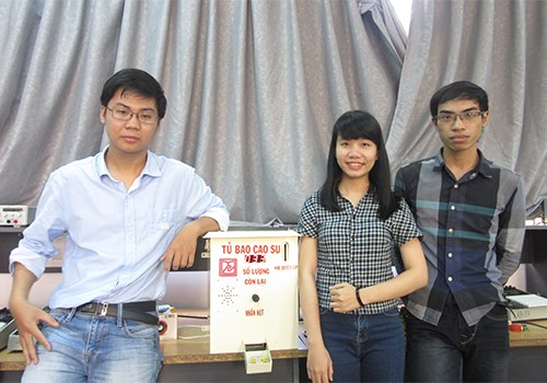 Three members among a team inventing a condom distribution machine in Da Nang. Photo credit: Van Anh/VnExpress
