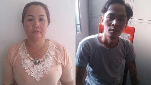 Nguyen Kim Ngan (L) and Ngo Tien Long, two alleged leaders of a gang extorting money from sex workers in Ho Chi Minh City. Photo credit: VietNamNet
