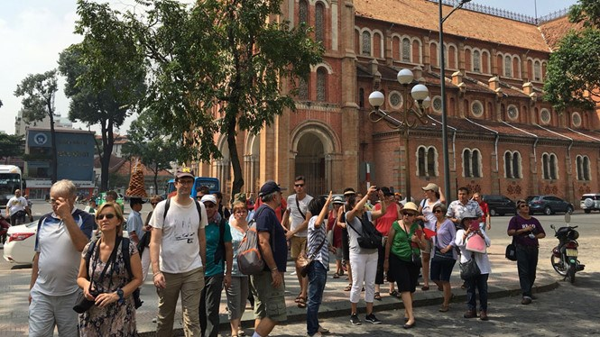 Foreign tourists at the site near the Saigon Notre Dame Cathedral in Ho Chi Minh City's District 1. Photo: Tran Tam