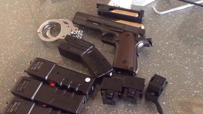 Taser guns and other weapons police seized from a man in Ho Chi Minh City on January 25, 2016 as he was delivering them to a customer. Photo: Nguyen Bao