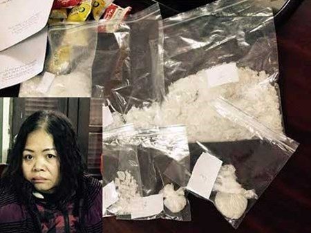 Nguyen Bich Lan and the meth she was caught with her husband in Cao Bang Province February 11. Photo credit: Cong An Nhan Dan Newspaper