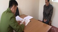A photo supplied by the police shows Ma Duy Tuan being interrogated in Lang Son Province for human trafficking.