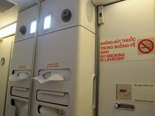 No smoking warnings inside an aircraft toilet. Photo credit: Giao Thong newspaper