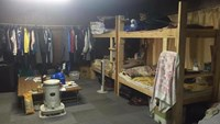 A photo shared by a Vietnamese worker in Japan shows a small and dark room for nine of them.