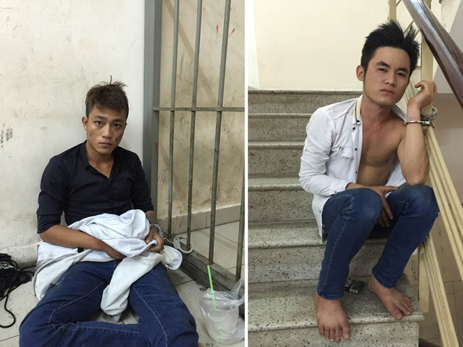 Two men arrested in Ho Chi Minh City March 21 for snatching the bag from a Russian tourist. Photo: Nguyen Bao