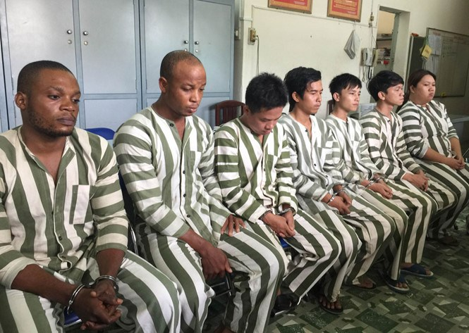 Two Nigerians (L) among seven members of a con ring who were arrested in Ho Chi Minh City earlier this month. Photo: Dam Huy