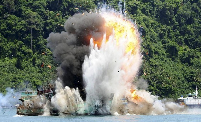 Vietnamese fishing boats are blown up for violating Indonesia waters. Photo credit: Reuters