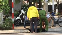 A police officer helps retrieve a phone for a South Korean man (in yellow) in Da Nang April 9, according to a photo on a local Facebook page.
