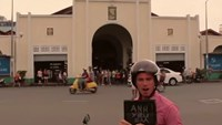 Andrew Davey in front of Ben Thanh Market in Ho Chi Minh City in a new music video on his YouTube channel.