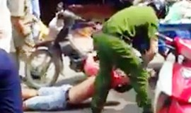 Video shows cop knocking down street vendor in Ho Chi Minh City