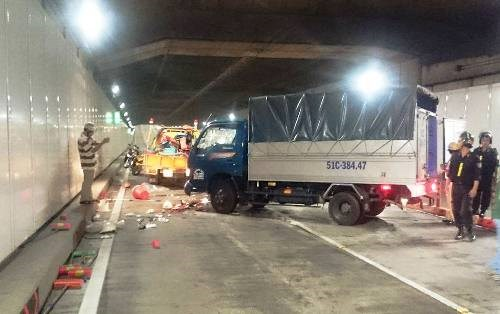 Police examine the site where a truck crashes into cleaning workers inside the Saigon River Tunnel on April 19, 2016. Photo courtesy of HCMC Police