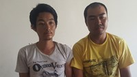 Two Chinese arrested for trying to rob a car in Ho Chi Minh City. Photo: Nguyen Bao/Thanh Nien