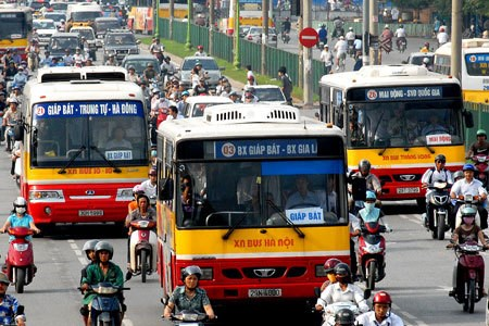 Public buses in Hanoi have to compete with more individual vehicles. Photo credit: VnExpress