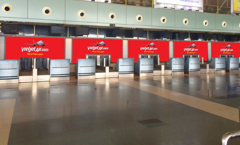 Vietjet's check-in booths at T1 terminal in A lobby, Noi Bai Airport.