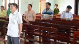 Tran Quang Hung, former district chief prosecutor in Kon Tum Province, stands at a trial on May 5, 2016. Photo: Dac Vinh/Thanh Nien