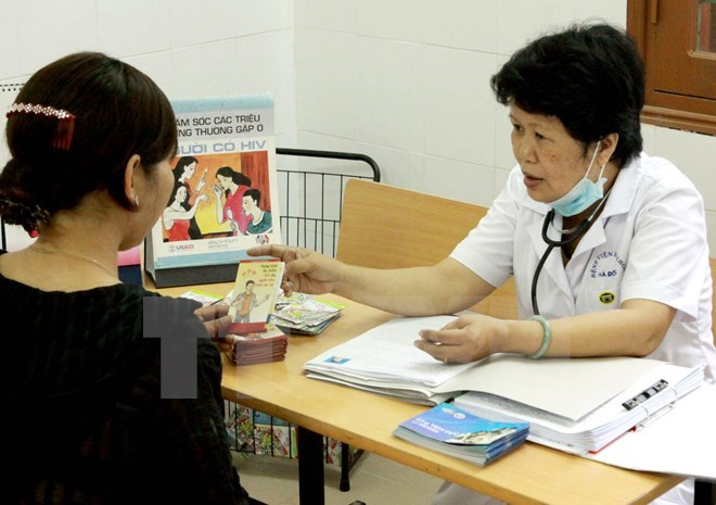 A woman receives HIV prevention consultancy. Photo credit: VietnamPlus