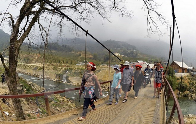 Foreign tourists in a trip to Vietnam's northern highlands. Photo: Thanh Ha/VietnamPlus