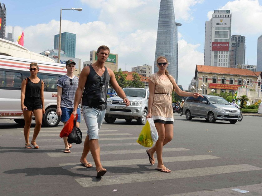 Foreign tourists in Ho Chi Minh downtown. Photo: Tran Tam