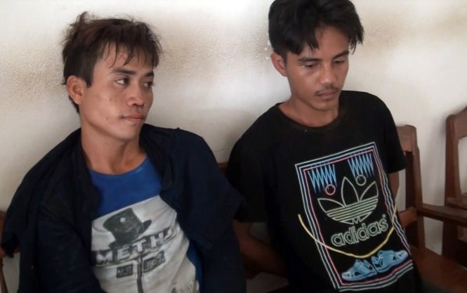 Two Lao men arrested on June 18 for attempting to bring drugs to Vietnam. Photo credit: Tuoi Tre