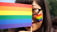 A girl holds the rainbow LGBT flag at a campaign for same-sex marriage in Hanoi. Photo: Ngu Thien