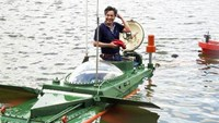 Nguyen Quoc Hoa and his second mini-submarine. Photo: Giang Chinh/VnExpress