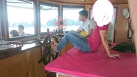 A photo on Gia Dinh Viet Nam news website shows a man driving a cruise on Ha Long Bay with feet.