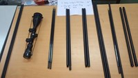Gun barrels and a riflescope Hanoi seized from packages from the US and the UK. Photo provided by Hanoi Customs