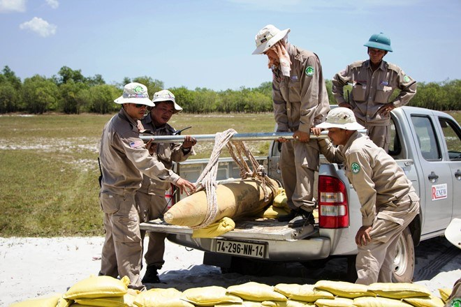 A Vietnam War bomb found in the central province of Quang Tri is moved to a safe disposal site July 27, 2016. Photo courtesy of RENEW