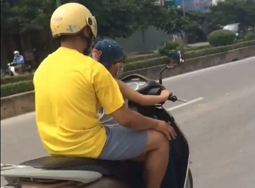 A screenshot from an online video shows a boy riding a motorbike on Hanoi street.