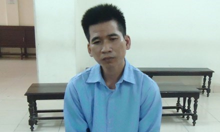 Tang Dinh Loc stands trial in Hanoi on August 9 for human trafficking. Photo credit: Tien Phong