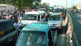 An ambulance car is stuck in traffic in Ho Chi Minh City. Photo: An Bang