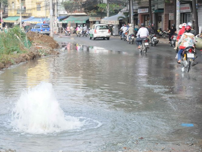 Water comes out of a broken pipe in Ho Chi Minh City. Photo: Diep Duc Minh