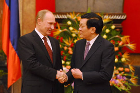 Energy, military deals inked as Putin visits Vietnam