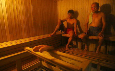 Beau In This Photo Taken On March 18, 2013, Two Patients Are Seen At A Sauna  Room With Two Loaves Of Bread Heated Up At The Health Center Of Vietnam  Association ...