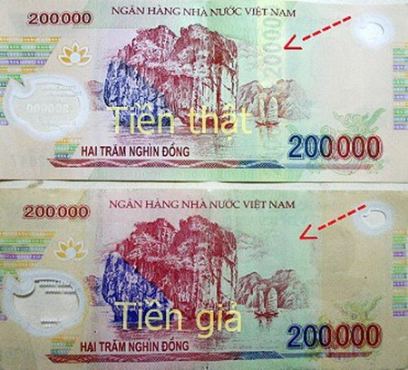 Vietnam central bank shows how to identify fake currency