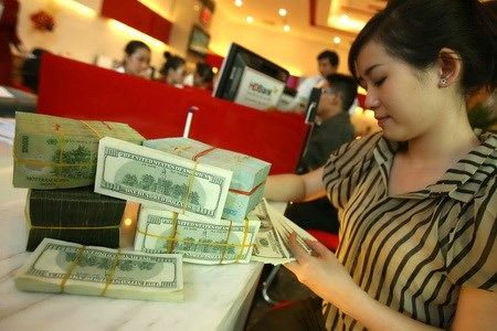 A Client Deposits Money In Vietnamese Dong And Us Dollar At Bank Ho Chi Minh City