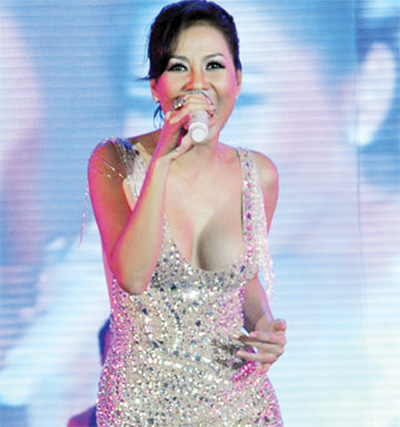 Vietnam singer suspended, fined for revealing clothes