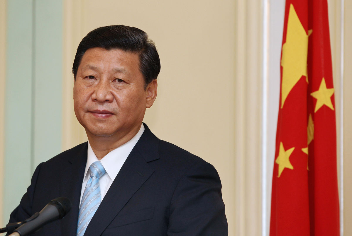 Xi says China must adapt to 'new normal' of slower growth