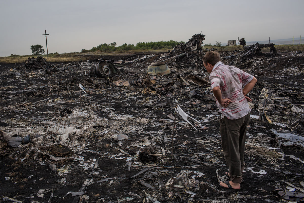 Tensions mount over Ukraine jet crash as corpses moved