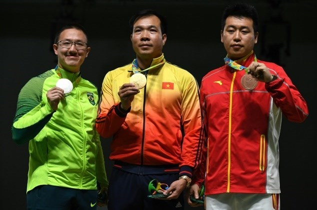 Shooter Hoang Xuan Vinh wins historic first Olympic gold medal for Vietnam