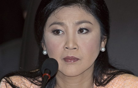 Thai court rules PM must step down but ministers remain